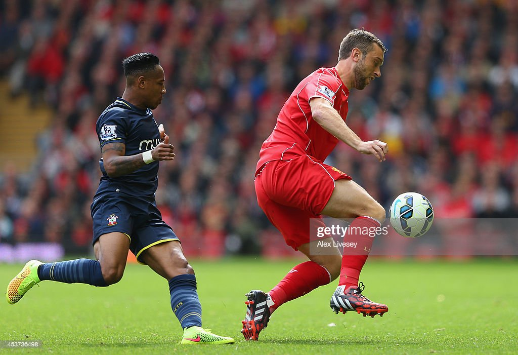<a gi-track='captionPersonalityLinkClicked' href=/galleries/search?phrase=Rickie+Lambert&family=editorial&specificpeople=4124959 ng-click='$event.stopPropagation()'>Rickie Lambert</a> of Liverpool turns away from <a gi-track='captionPersonalityLinkClicked' href=/galleries/search?phrase=Nathaniel+Clyne+-+Soccer+Player&family=editorial&specificpeople=5738873 ng-click='$event.stopPropagation()'>Nathaniel Clyne</a> of Southampton during the Barclays Premier League match between Liverpool and Southampton at Anfield on August 17, 2014 in Liverpool, England.