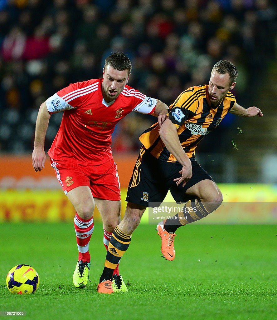 <a gi-track='captionPersonalityLinkClicked' href=/galleries/search?phrase=Rickie+Lambert&family=editorial&specificpeople=4124959 ng-click='$event.stopPropagation()'>Rickie Lambert</a> of Southampton and David Meyler of Hull City battle for the ball during the Barclays Premier League match between Hull City and Southampton at the KC Stadium on February 11, 2014 in Hull, England.