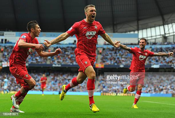 Rickie Lambert of Southampton celebrates scoring his team's first goal during the Barclays Premier League match between Manchester City and...