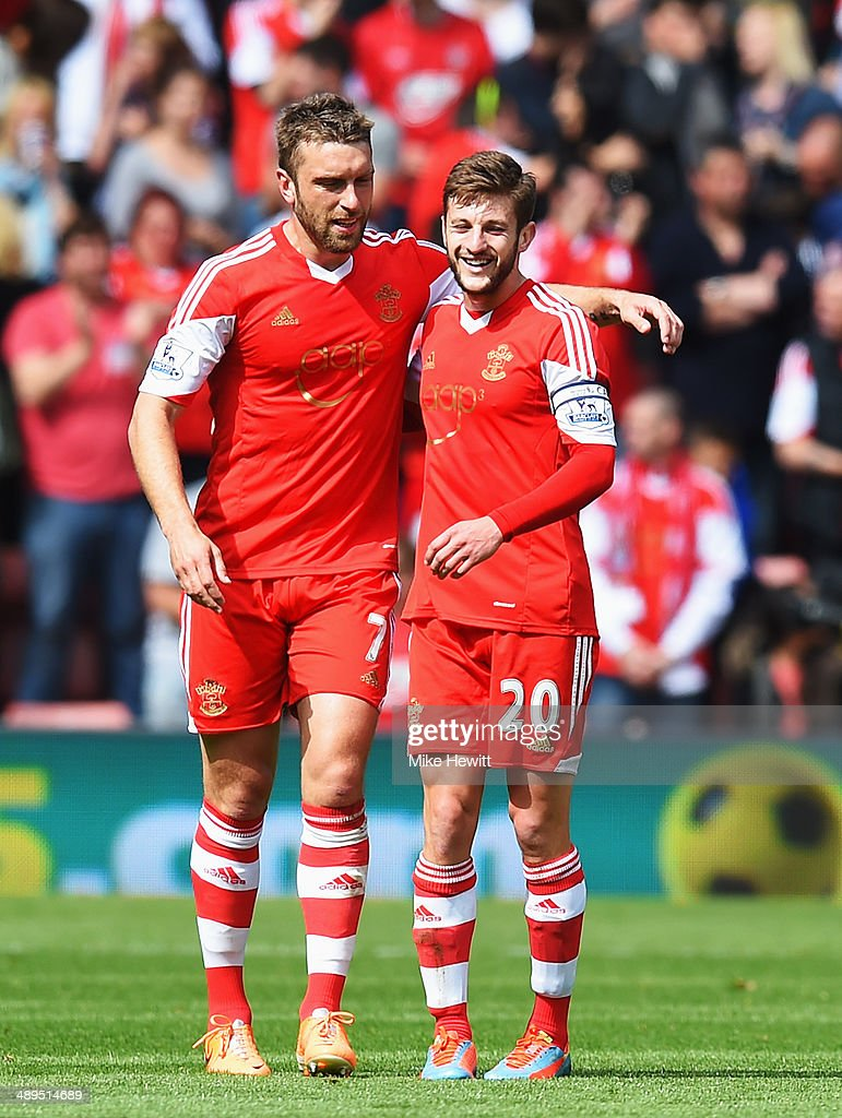 <a gi-track='captionPersonalityLinkClicked' href=/galleries/search?phrase=Rickie+Lambert&family=editorial&specificpeople=4124959 ng-click='$event.stopPropagation()'>Rickie Lambert</a> (L) of Southampton celebrates with team mate <a gi-track='captionPersonalityLinkClicked' href=/galleries/search?phrase=Adam+Lallana&family=editorial&specificpeople=5475862 ng-click='$event.stopPropagation()'>Adam Lallana</a> (R) after scoring during the Barclays Premier League match between Southampton and Manchester United at St Mary's Stadium on May 11, 2014 in Southampton, England.