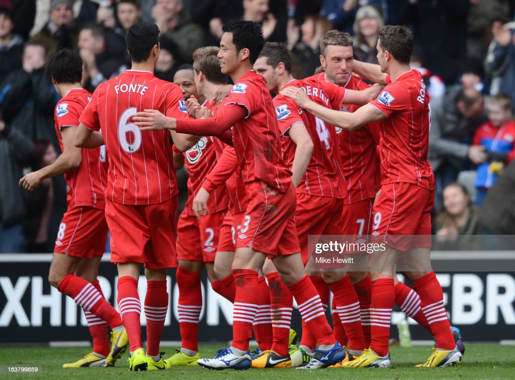 Rickie Lambert of Southampton celebrates with team mates after scoring their second goal during the Barclays Premier League match between Southampton and Liverpool at St Mary's Stadium on March 16, 2013 in Southampton, England.
