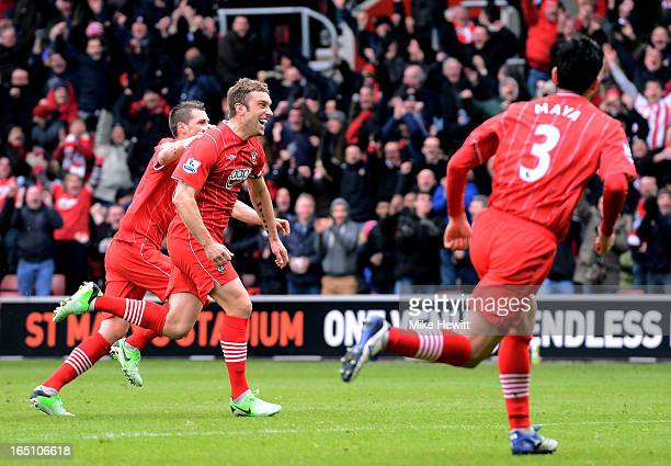 Rickie Lambert of Southampton celebrates with teammates after scoring his team's second goal with a free kick during the Barclays Premier League...