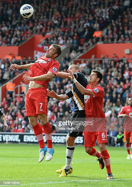 Rickie Lambert of Southampton gets above Brede Hangeland of Fulham and team mate Jose Fonte during the Barclays Premier League match between...
