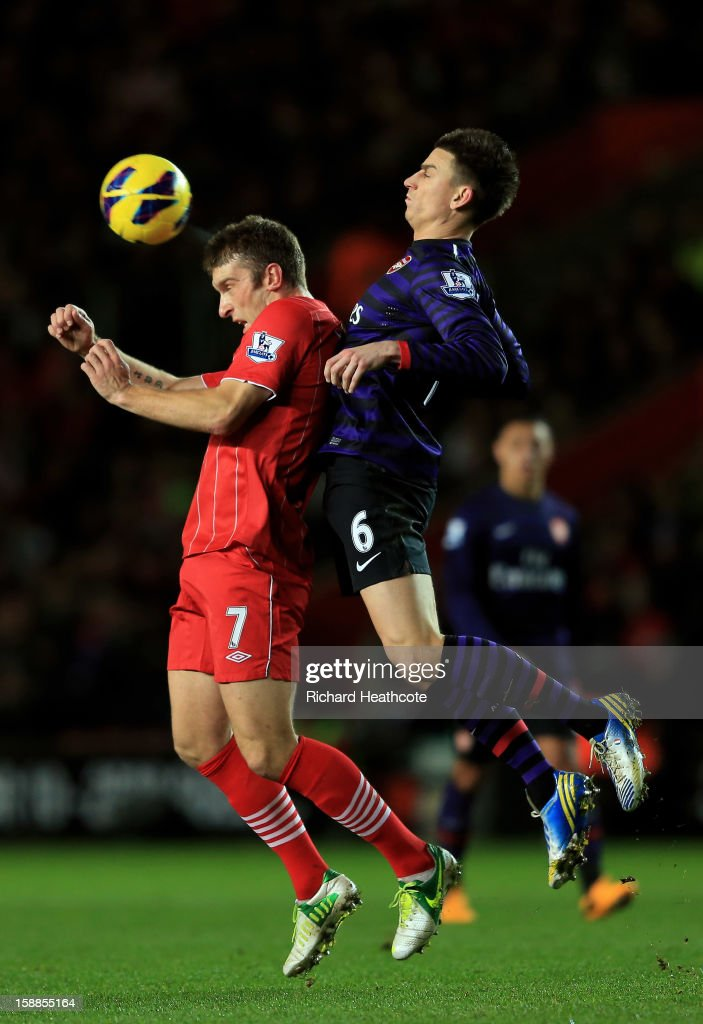 Rickie Lambert of Southampton heads the ball under pressure from Laurent Koscielny of Arsenal during the Barclays Premier league match between Southampton and Arsenal at St Mary's Stadium on January 1, 2013 in Southampton, England.