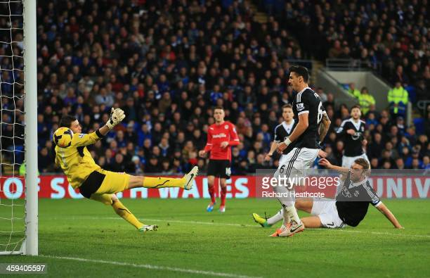 Rickie Lambert of Southampton scores his teams third goal during the Barclays Premier League match between Cardiff City and Southampton at Cardiff...
