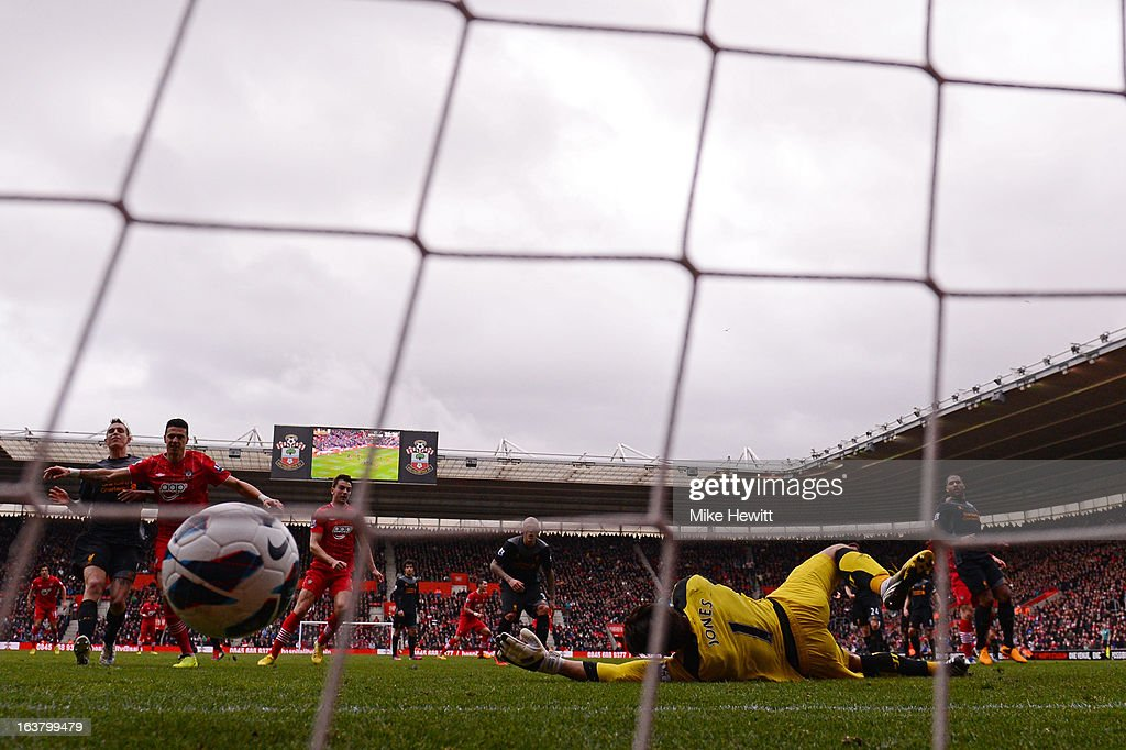 Rickie Lambert of Southampton (not pictured) scores their second goal from a freekick past goalkeeper <a gi-track='captionPersonalityLinkClicked' href=/galleries/search?phrase=Brad+Jones+-+Soccer+Player&family=editorial&specificpeople=643165 ng-click='$event.stopPropagation()'>Brad Jones</a> of Liverpool during the Barclays Premier League match between Southampton and Liverpool at St Mary's Stadium on March 16, 2013 in Southampton, England.