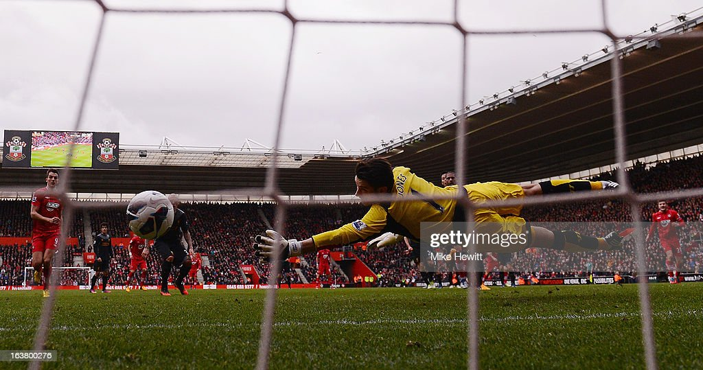 Rickie Lambert of Southampton (not pictured) scores their second goal from a freekick past goalkeeper Brad Jones of Liverpool at St Mary's Stadium on March 16, 2013 in Southampton, England.