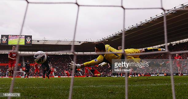Rickie Lambert of Southampton scores their second goal from a freekick past goalkeeper Brad Jones of Liverpool at St Mary's Stadium on March 16 2013...