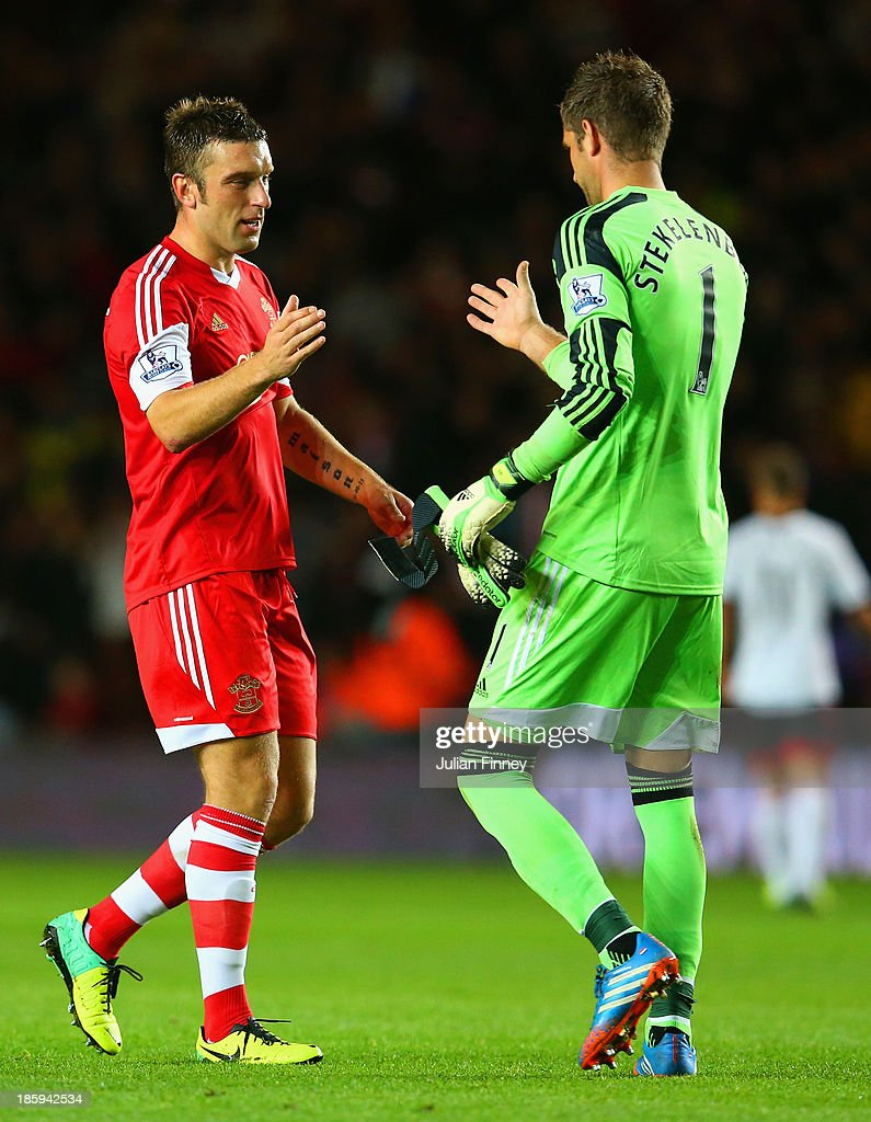 <a gi-track='captionPersonalityLinkClicked' href=/galleries/search?phrase=Rickie+Lambert&family=editorial&specificpeople=4124959 ng-click='$event.stopPropagation()'>Rickie Lambert</a> of Southampton shakes hands with <a gi-track='captionPersonalityLinkClicked' href=/galleries/search?phrase=Maarten+Stekelenburg&family=editorial&specificpeople=615201 ng-click='$event.stopPropagation()'>Maarten Stekelenburg</a> of Fulham at the final whistle during the Barclays Premier League match between Southampton and Fulham at St Mary's Stadium on October 26, 2013 in Southampton, England.