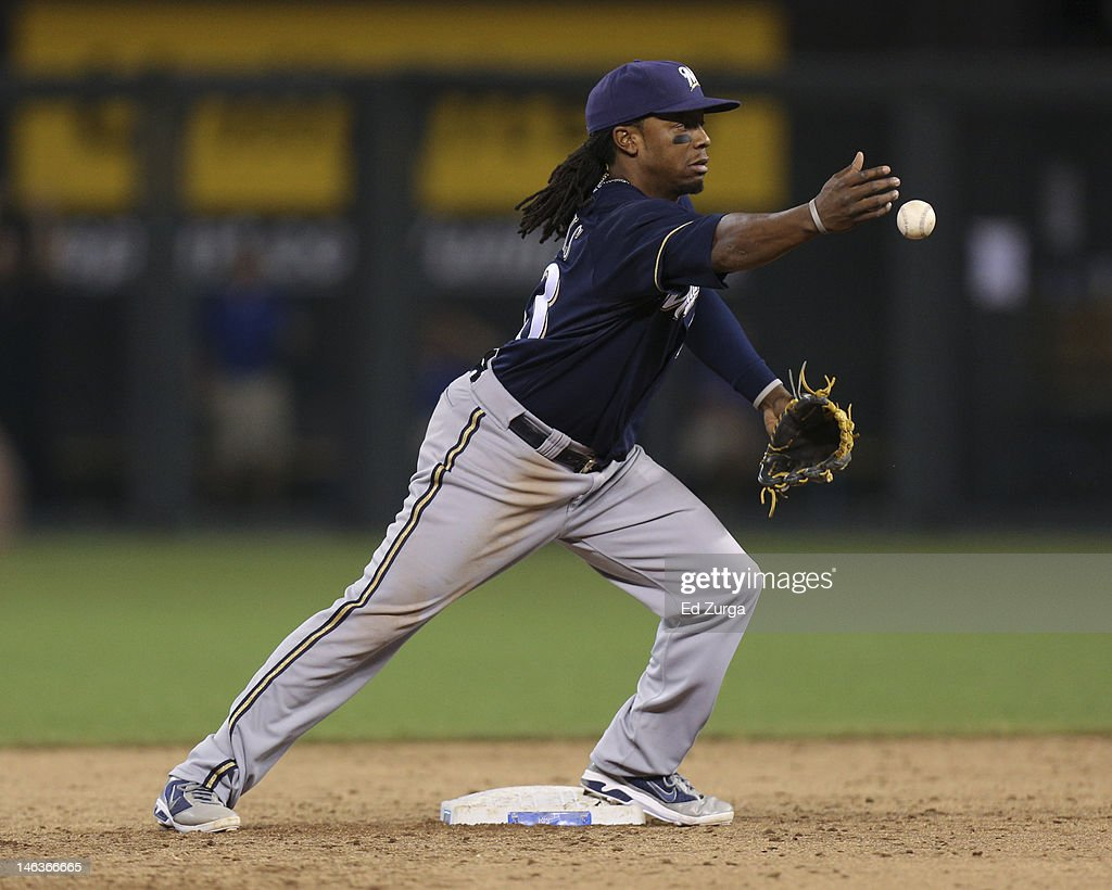 Rickie Weeks #23 of the Milwaukee Brewers bobbles a ball during an interleague game against the Kansas City Royals in the ninth inning at Kauffman Stadium on June 14, 2012 in Kansas City, Missouri. The Royals would score the game-winng run on the play for a 4-3 win.