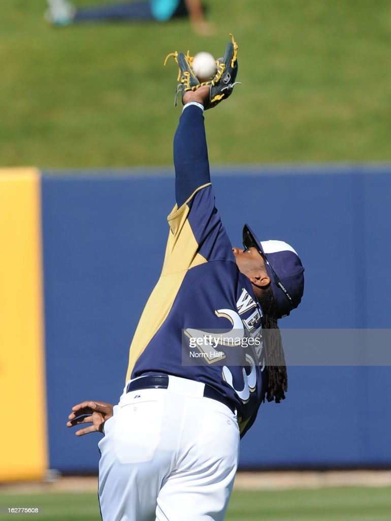 <a gi-track='captionPersonalityLinkClicked' href=/galleries/search?phrase=Rickie+Weeks&family=editorial&specificpeople=550245 ng-click='$event.stopPropagation()'>Rickie Weeks</a> #23 of the Milwaukee Brewers catches a pop fly against the Seattle Mariners at Maryvale Baseball Park on February 26, 2013 in Maryvale, Arizona.