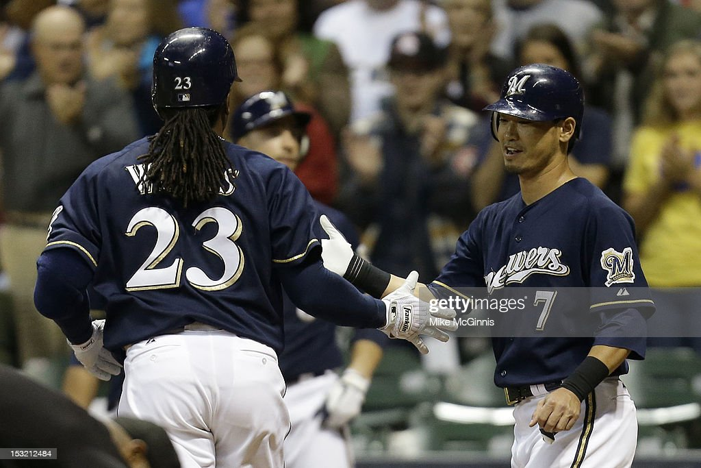 <a gi-track='captionPersonalityLinkClicked' href=/galleries/search?phrase=Rickie+Weeks&family=editorial&specificpeople=550245 ng-click='$event.stopPropagation()'>Rickie Weeks</a> #23 of the Milwaukee Brewers celebrates after hitting a two-run homer in the bottom of the 5th inning scoring <a gi-track='captionPersonalityLinkClicked' href=/galleries/search?phrase=Norichika+Aoki&family=editorial&specificpeople=850957 ng-click='$event.stopPropagation()'>Norichika Aoki</a> against the San Diego Padres at Miller Park on October 1, 2012 in Milwaukee, Wisconsin.