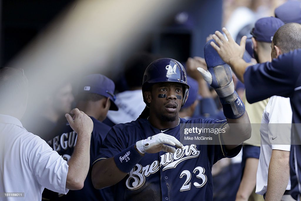 <a gi-track='captionPersonalityLinkClicked' href=/galleries/search?phrase=Rickie+Weeks&family=editorial&specificpeople=550245 ng-click='$event.stopPropagation()'>Rickie Weeks</a> #23 of the Milwaukee Brewers celebrates in the dugout after getting hit home by Aramis Ramirez in the bottom of the 4th inning against the Pittsburgh Pirates at Miller Park on September 02, 2012 in Milwaukee, Wisconsin.
