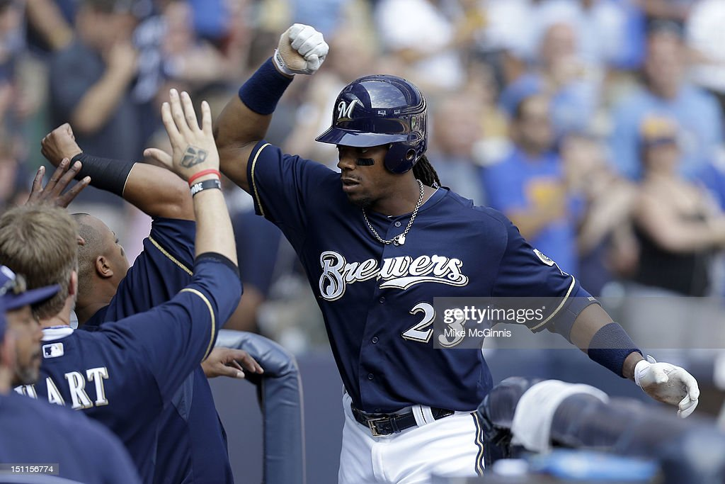 <a gi-track='captionPersonalityLinkClicked' href=/galleries/search?phrase=Rickie+Weeks&family=editorial&specificpeople=550245 ng-click='$event.stopPropagation()'>Rickie Weeks</a> #23 of the Milwaukee Brewers celebrates outside the dugout after hitting a two run homer in the bottom of the 2nd inning scoring Norichika Aoki against the Pittsburgh Pirates at Miller Park on September 02, 2012 in Milwaukee, Wisconsin.