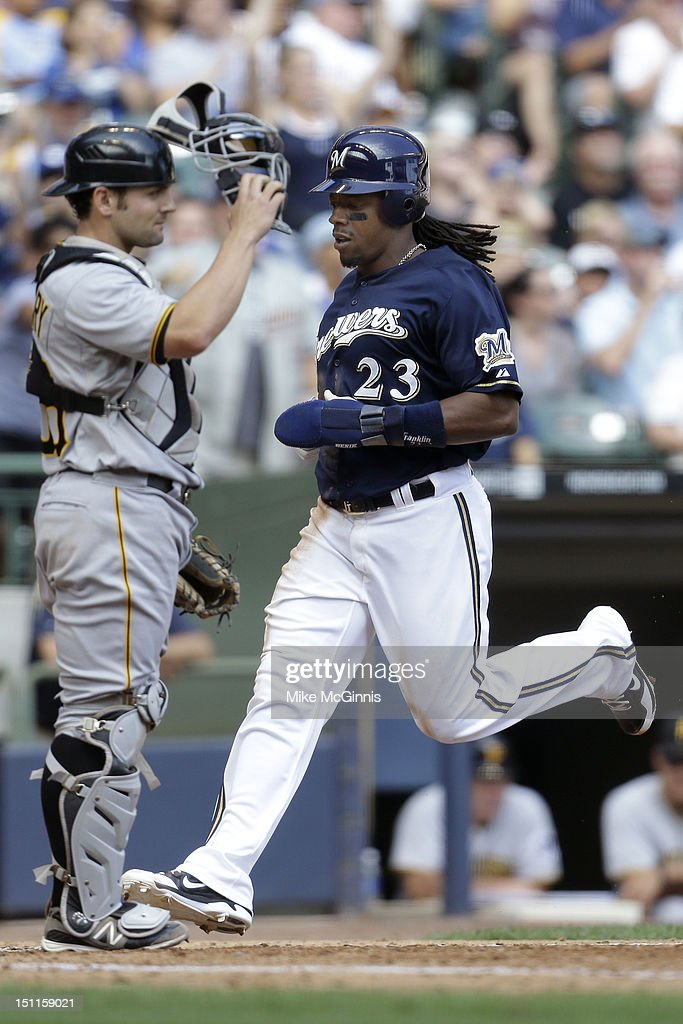 <a gi-track='captionPersonalityLinkClicked' href=/galleries/search?phrase=Rickie+Weeks&family=editorial&specificpeople=550245 ng-click='$event.stopPropagation()'>Rickie Weeks</a> #23 of the Milwaukee Brewers crosses home plate on a single by Aramis Ramirez in the bottom of the 4th inning against the Pittsburgh Pirates at Miller Park on September 02, 2012 in Milwaukee, Wisconsin.