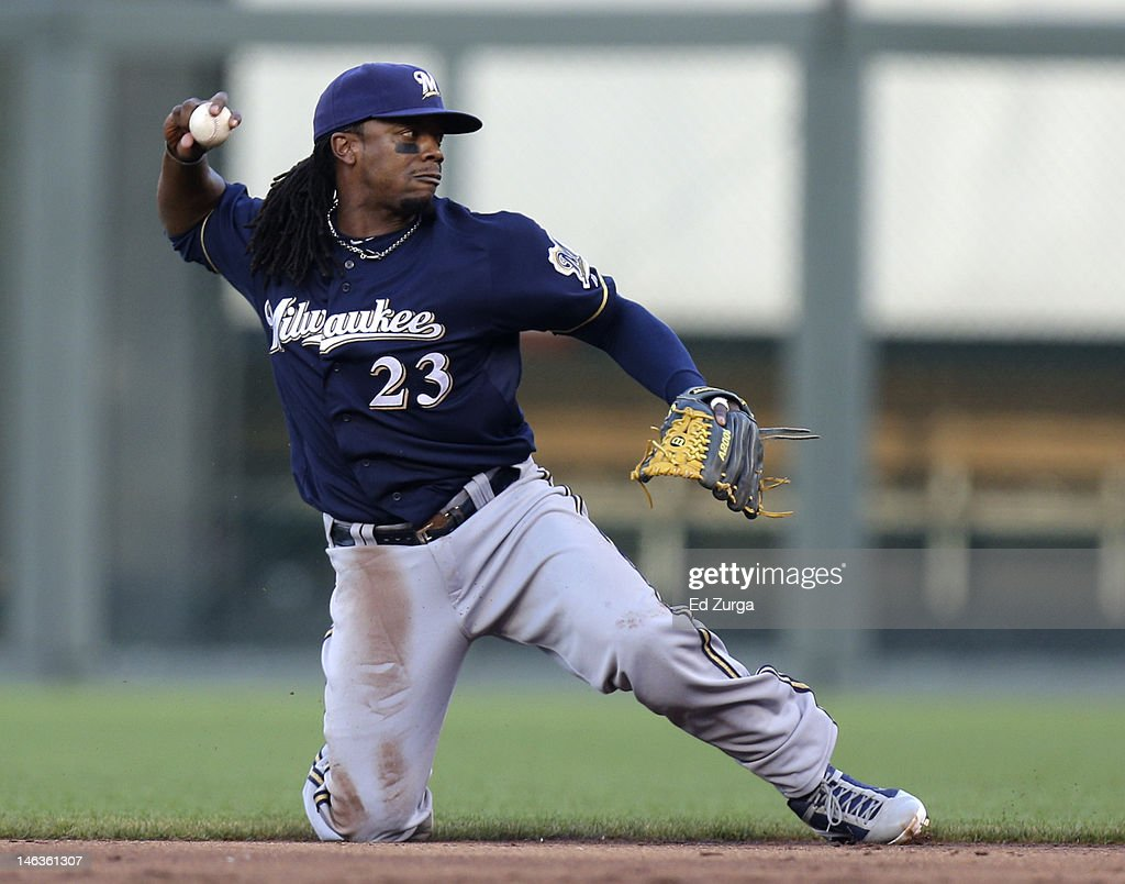 Rickie Weeks #23 of the Milwaukee Brewers fields a ball and throws out Eric Hosmer of the Kansas City Royals out at first during an interleague game at Kauffman Stadium on June 14, 2012 in Kansas City, Missouri.