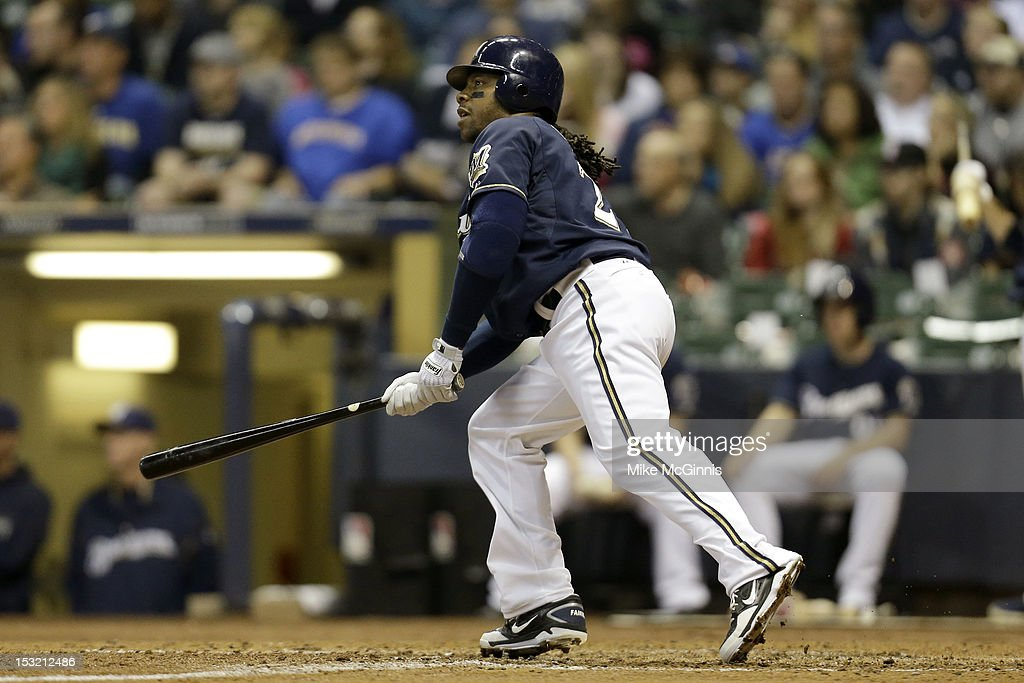 <a gi-track='captionPersonalityLinkClicked' href=/galleries/search?phrase=Rickie+Weeks&family=editorial&specificpeople=550245 ng-click='$event.stopPropagation()'>Rickie Weeks</a> #23 of the Milwaukee Brewers hits a two-run homer in the bottom of the 5th inning scoring Norichika Aoki against the San Diego Padres at Miller Park on October 1, 2012 in Milwaukee, Wisconsin.