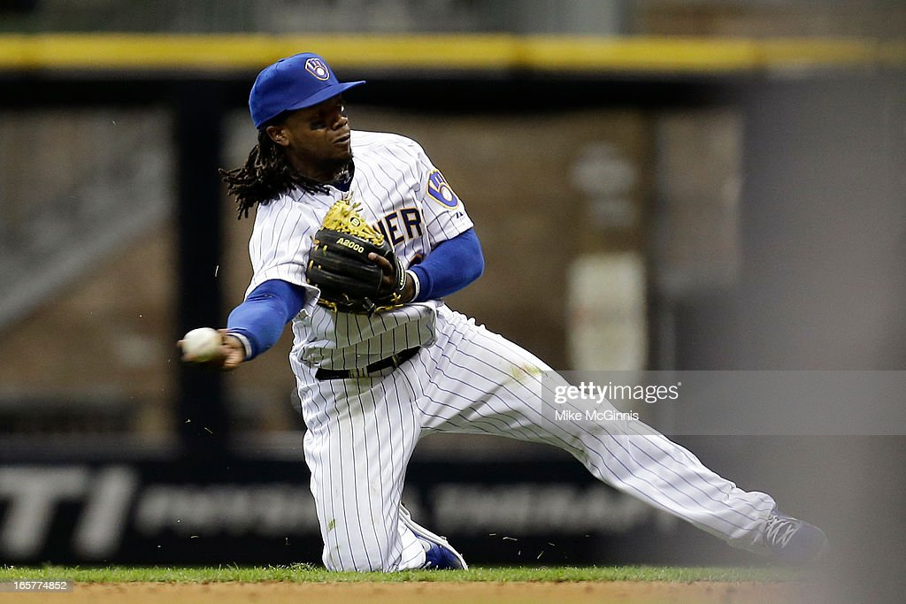 <a gi-track='captionPersonalityLinkClicked' href=/galleries/search?phrase=Rickie+Weeks&family=editorial&specificpeople=550245 ng-click='$event.stopPropagation()'>Rickie Weeks</a> #23 of the Milwaukee Brewers makes a diving grab and throw to get out A.J. Pollock of the Arizona Diamondbacks in the top of the ninth inning at Miller Park on April 5, 2013 in Milwaukee, Wisconsin.