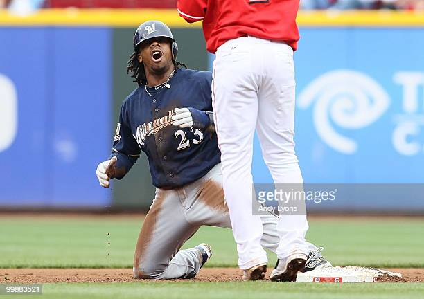 Rickie Weeks of the Milwaukee Brewers reacts after being tagged out while attempting to steal second base by Orlando Cabrera of the Cincinnati Reds...