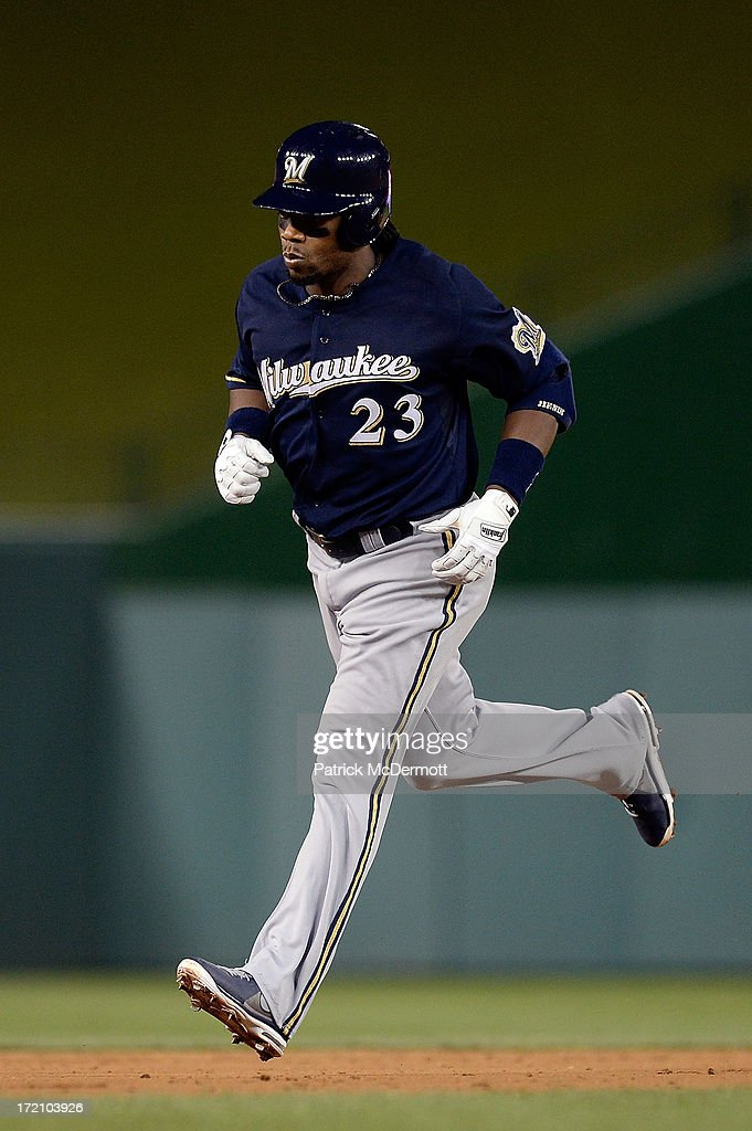 <a gi-track='captionPersonalityLinkClicked' href=/galleries/search?phrase=Rickie+Weeks&family=editorial&specificpeople=550245 ng-click='$event.stopPropagation()'>Rickie Weeks</a> #23 of the Milwaukee Brewers rounds second base after hitting a solo home run in the sixth inning during a game against the Washington Nationals at Nationals Park on July 1, 2013 in Washington, DC.