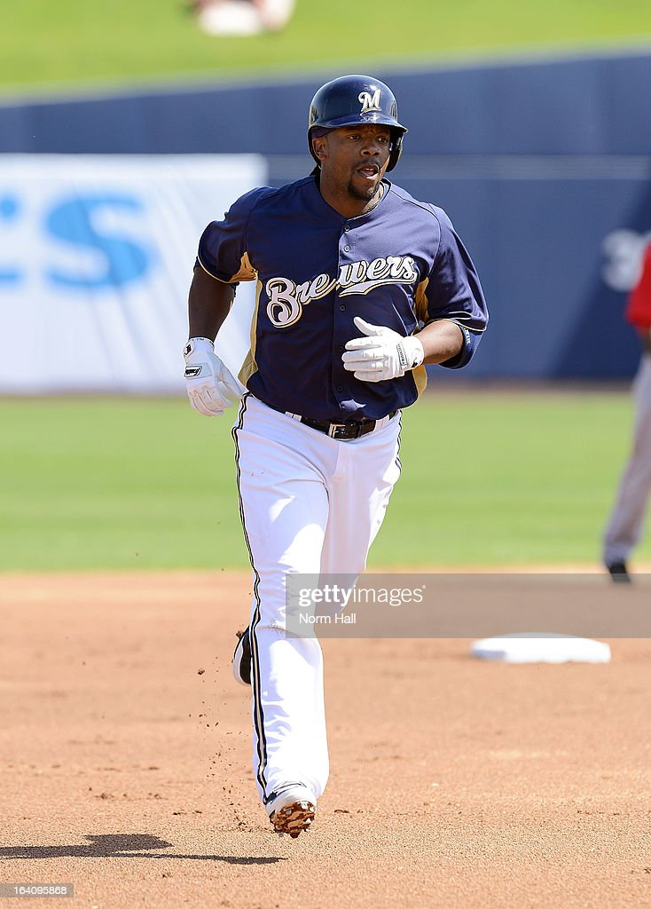 Rickie Weeks #23 of the Milwaukee Brewers rounds the bases after hitting a home run against the Los Angeles Angels of Anaheim at Maryvale Baseball Park on March 19, 2013 in Maryvale, Arizona.