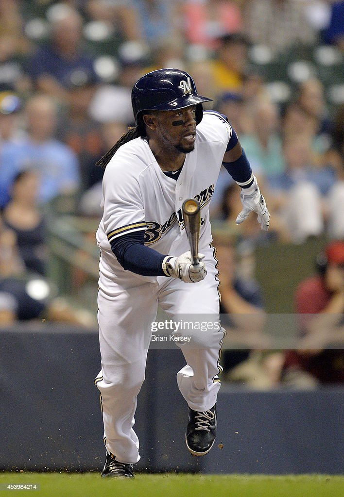 <a gi-track='captionPersonalityLinkClicked' href=/galleries/search?phrase=Rickie+Weeks&family=editorial&specificpeople=550245 ng-click='$event.stopPropagation()'>Rickie Weeks</a> #23 of the Milwaukee Brewers starts up the first base line after hitting an RBI single scoring teammate Ryan Braun during the eighth inning against the Pittsburgh Pirates at Miller Park on August 22, 2014 in Milwaukee, Wisconsin.