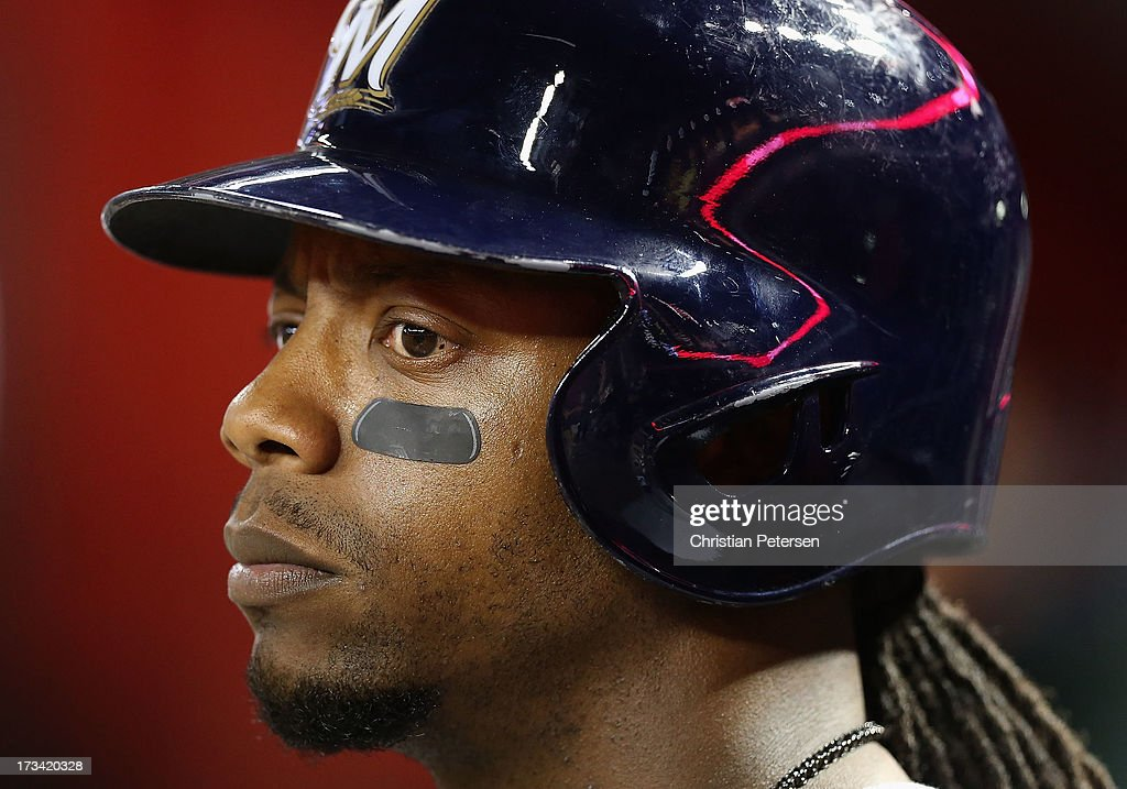 <a gi-track='captionPersonalityLinkClicked' href=/galleries/search?phrase=Rickie+Weeks&family=editorial&specificpeople=550245 ng-click='$event.stopPropagation()'>Rickie Weeks</a> #23 of the Milwaukee Brewers watches from the dugout during the MLB game against the Arizona Diamondbacks at Chase Field on July 13, 2013 in Phoenix, Arizona.