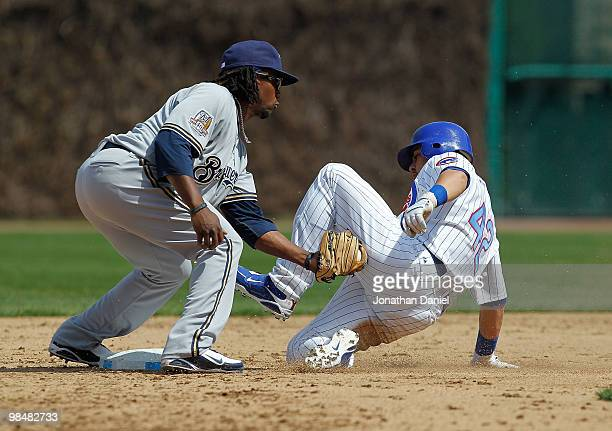 Rickie Weeks of the Milwaukee Brewers wearing a number 42 jersey in honor of Jackie Robinson tags out Geovany Soto of the Chicago Cubs also wearing a...
