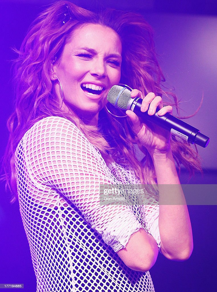 <a gi-track='captionPersonalityLinkClicked' href=/galleries/search?phrase=Ricki-Lee+Coulter&family=editorial&specificpeople=213884 ng-click='$event.stopPropagation()'>Ricki-Lee Coulter</a> performs live at the launch of Ricky-Lee's collection for Cotton On Body at Simmer On The Bay, Hickson Road, Dawes Point on August 22, 2013 in Sydney, Australia.
