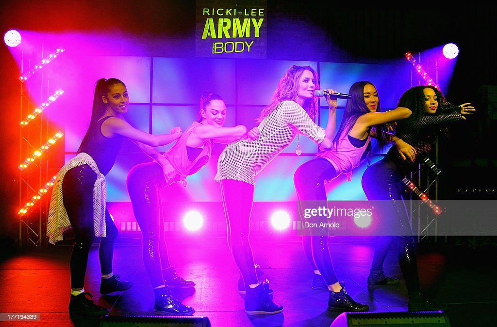 <a gi-track='captionPersonalityLinkClicked' href=/galleries/search?phrase=Ricki-Lee+Coulter&family=editorial&specificpeople=213884 ng-click='$event.stopPropagation()'>Ricki-Lee Coulter</a> performs live on stage at the launch of Ricky-Lee's collection for Cotton On Body at Simmer On The Bay, Hickson Road, Dawes Point on August 22, 2013 in Sydney, Australia.