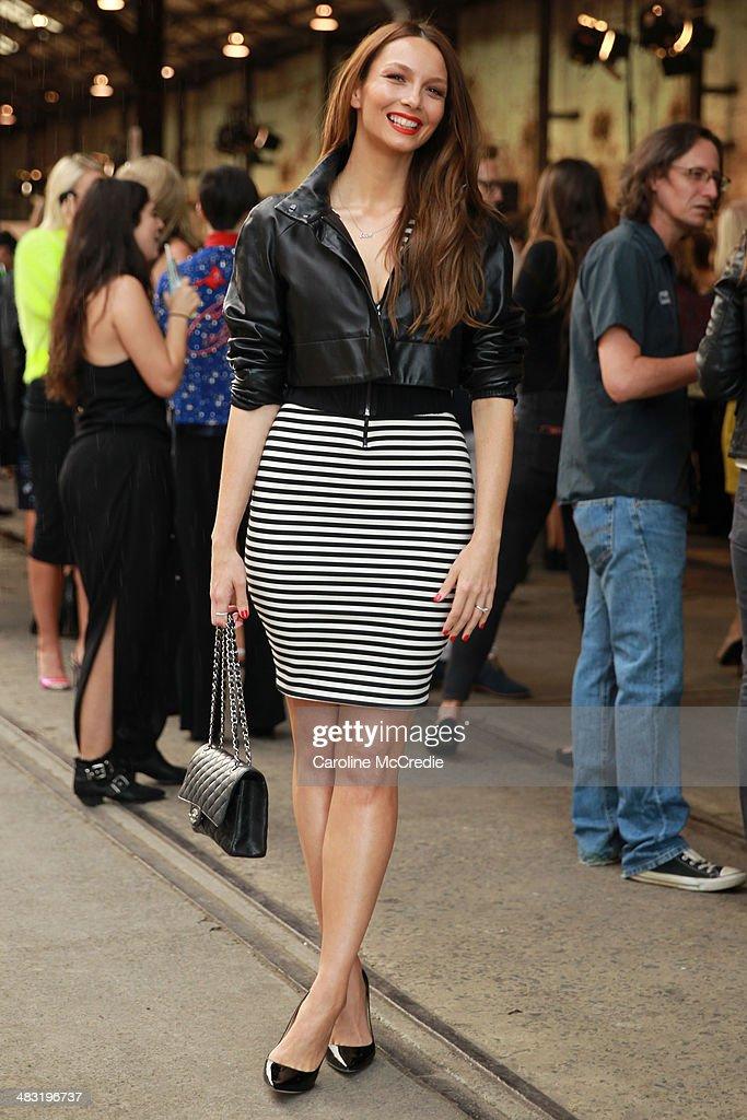 Ricki-Lee Coulter, wearing, Bec & Bridge skirt, Jimmy Choo shoes, Chanel handbag and Maticevski blazer, attends Mercedes-Benz Fashion Week Australia 2014 at Carriageworks on April 7, 2014 in Sydney, Australia.