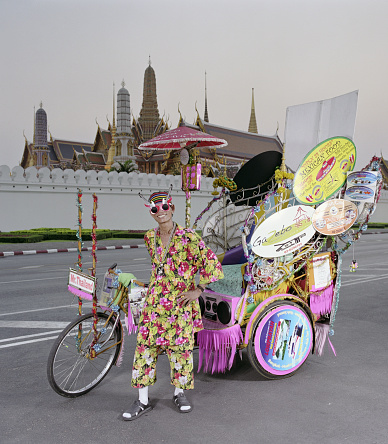 Rickshaw driver in front of the Grand Palace