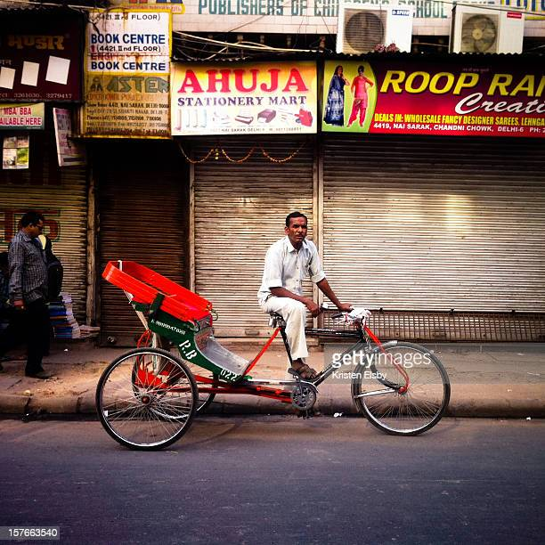 A rickshaw driver poses in Old Delhi