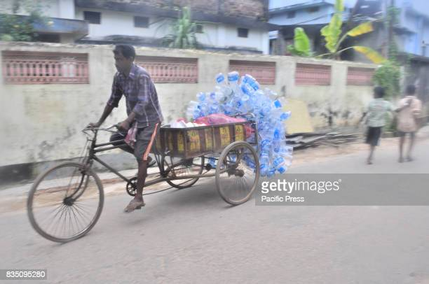 A rickshaw driver transports used plastic bottles for recycling in Agartala capital of the Northeastern state of Tripura