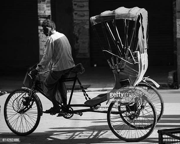 Rickshaw Passing In Back Street Of Varanasi