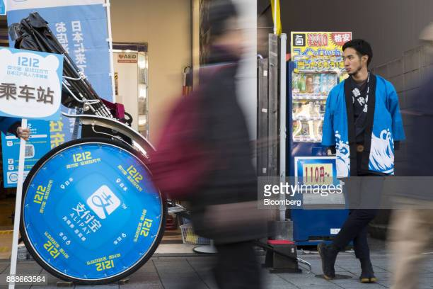 A rickshaw puller right waits for customers during a campaign event for Ant Financial Services Group's Alipay an affiliate of Alibaba Group Holding...