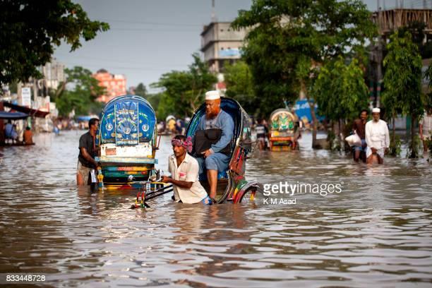 AGRABAD DHAKA CHITTAGONG BANGLADESH Rickshaw puller transport passenger in flooded areas of Chittagong Chittagong city is facing unprecedented...