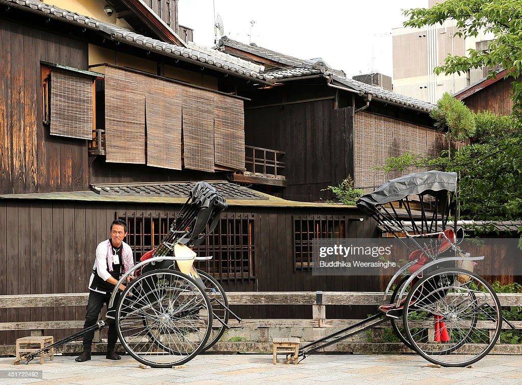 A rickshaw puller waits for tourists at Gion street on July 5, 2014 in Kyoto, Japan. Kyoto has been named the world's best city in the U.S. magazine Travel + Leisure for 2014, according to its website. The former capital of Japan is known for old temples and shrines.