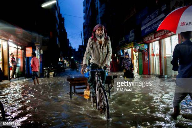 Rickshaw puller when heavy rainfall made waterlogging in Dhaka city The death toll rises to 150 in several hill districts including Banderban...