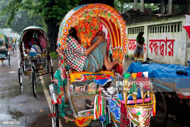 UNIVERCITY DHAKA BANGLADESH Rickshaw pullers take rest in the side of the road heavy rainfall made in Dhaka city The death toll rises to 156 in...