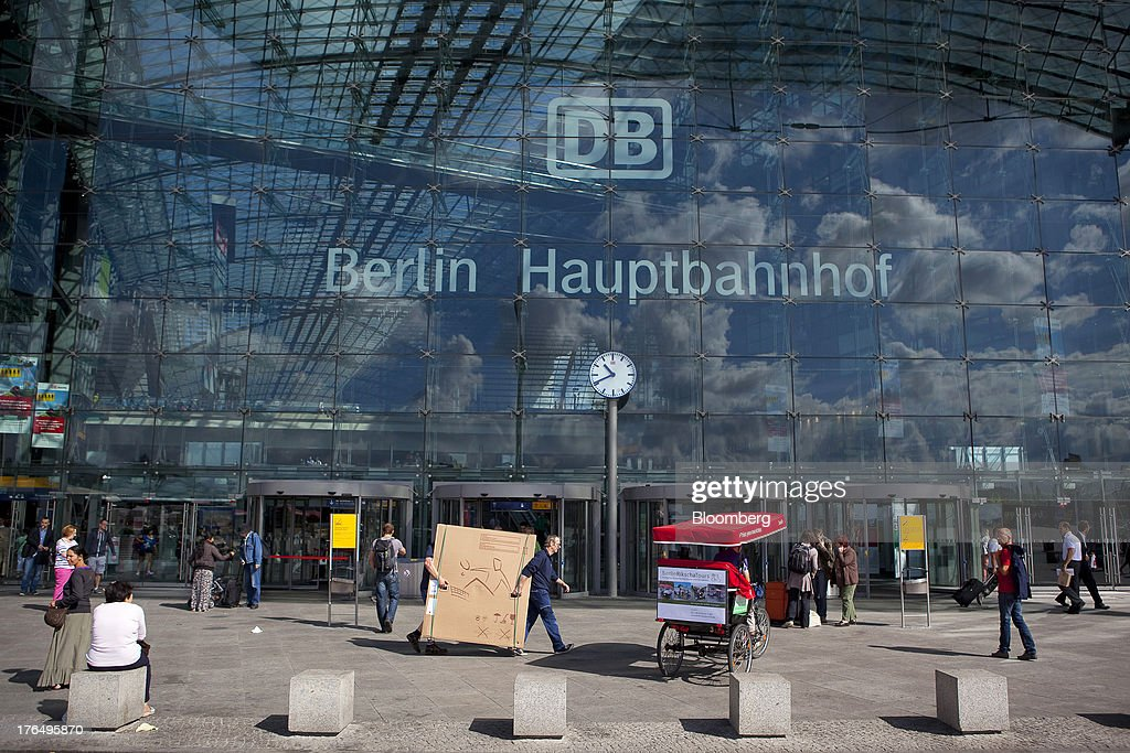 A rickshaw sits parked outside Berlin Central Station, also known as Hauptbahnhof, as pedestrians pass, in Berlin, Germany, on Tuesday, Aug. 13, 2013. German gross domestic product rose 0.7 percent from the first quarter and the French economy expanded 0.5 percent, the countries' national statistics offices said today. Photographer: Krisztian Bocsi/Bloomberg via Getty Images
