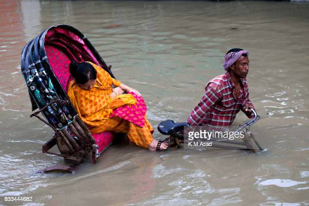 AGRABAD DHAKA CHITTAGONG BANGLADESH A rickshaw wades through a flooded area of Chittagong People traveling in flooded areas in Chittagong Chittagong...