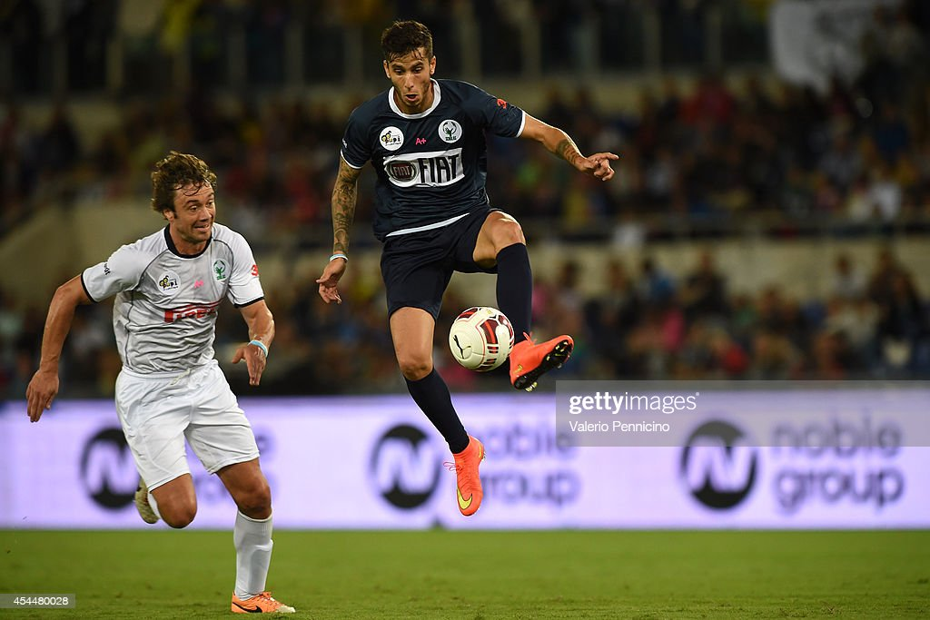 Ricky Alvarez in action against Diego Lugano during the Interreligious Match For Peace at Olimpico Stadium on September 1 2014 in Rome Italy