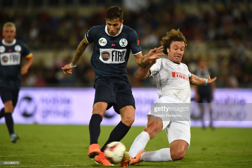 Ricky Alvarez is challenged by Diego Lugano during the Interreligious Match For Peace at Olimpico Stadium on September 1 2014 in Rome Italy