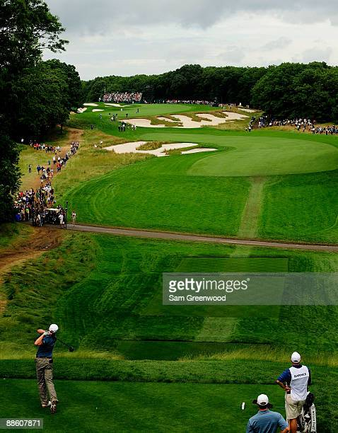 Ricky Barnes hits his tee shot on the fourth hole during the continuation of the third round of the 109th US Open on the Black Course at Bethpage...