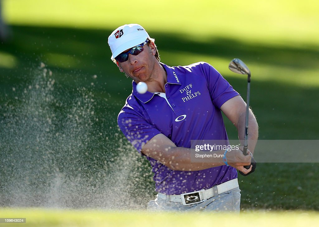 Ricky Barnes hits out of a bunker on the 15th hole during the first round of the Humana Challenge in partnership with the Clinton Foundation at La Quinta Country Club on January 17, 2013 in La Quinta, California.