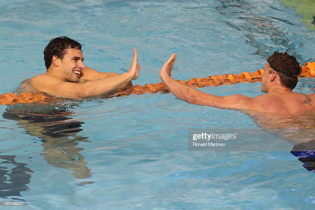 Ricky Berens slaps hands with Ryan Lochte after winning the Men's 200 Freestyle during day two of the 2012 AT&T Winter National Championships on November 30, 2012 at the Lee and Joe Jamail Texas Swimming Center in Austin, Texas.