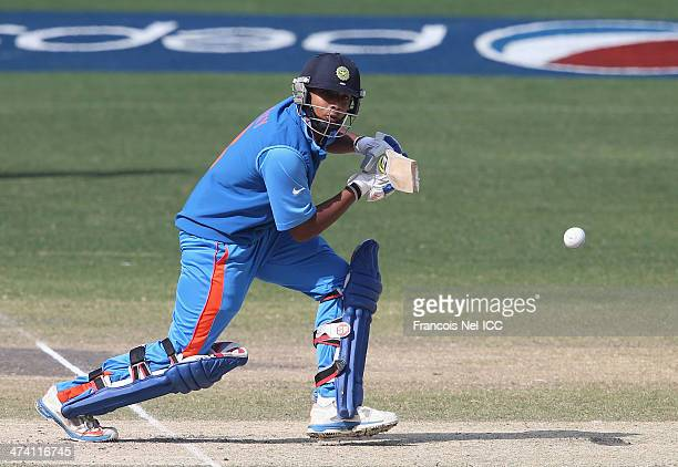 Ricky Bhui of India bats during the ICC U19 Cricket World Cup 2014 Quarter Final match between England and India at the Dubai Sports City Cricket...