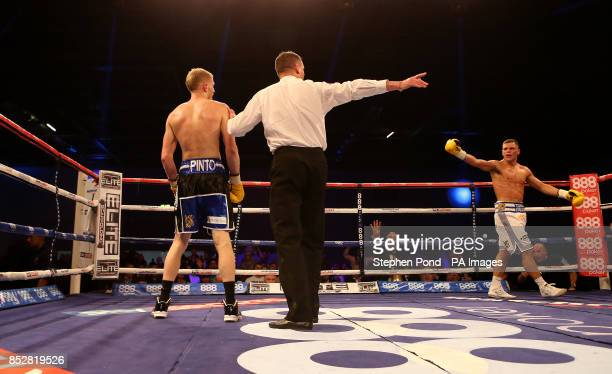 Ricky Boylan is sent to the corner by the referee after knocking down Tony Owen in their their Southern Area LightWelterweight Title fight at the...