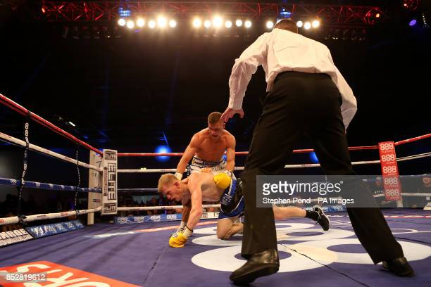 Ricky Boylan knocks down Tony Owen in their their Southern Area LightWelterweight Title fight at the ExCel Arena London